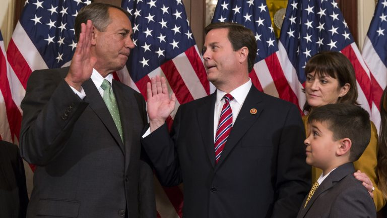 Speaker of the House Rep. John Boehner, R-Ohio, left, poses for a photo with Representative-elect Donald Norcross, D-N.J., center, during a ceremonial swearing-in ceremony on Capitol Hill, on Wednesday, Nov. 12, 2014. (AP Photo/Evan Vucci)
