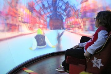 8-year-old Lily thought it was 'awesome' watching a 4D story of Shrek and Donkey traveling to the North Pole (Natavan Werbock/for NewsWorks)