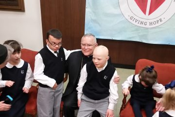 Philadelphia Archbishop Charles Chaput and special-needs children at Catholic Charities announcement. (Tom MacDonald/WHYY)