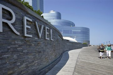 Casino workers and customers walk out of The Revel Hotel Casino together early in the morning Tuesday, Sept. 2, 2014. (AP Photo/Mel Evans)