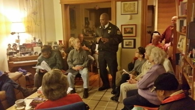 Captain Sekou Kinebrew meets with members of the Mt. Airy-Nippon-Bryan-Cresheim Town Watch. (Queen Muse/for NewsWorks)