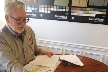 Contractor Larry Steimel reviews the insurance adjuster estimate of one of his clients whose home was flooded during Sandy.