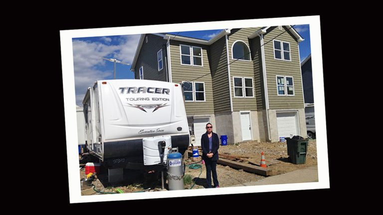 Andrea Kassimatis and her family of five are still living in a 37-foot trailer as they wait for contractors to finish building their new home.