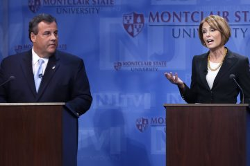 Gov. Chris Christie, left, listens as Democratic challenger Barbara Buono answers a question during their debate Tuesday, Oct. 15, 2013. (AP Photo/Mel Evans)
