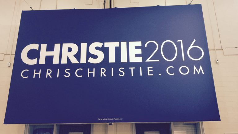A Christie hanging inside the Livingston High School gym this morning. (Phil Gregory/for NewsWorks)