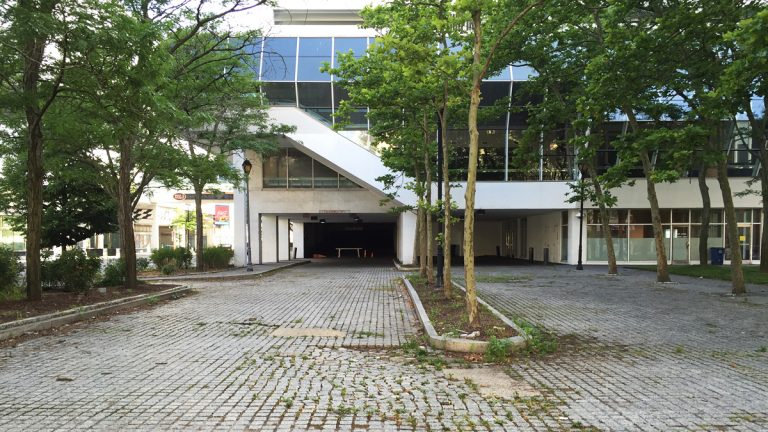 Weeds are now appearing in the driveway of the Trump Plaza parking garage. (Alan Tu/WHYY)
