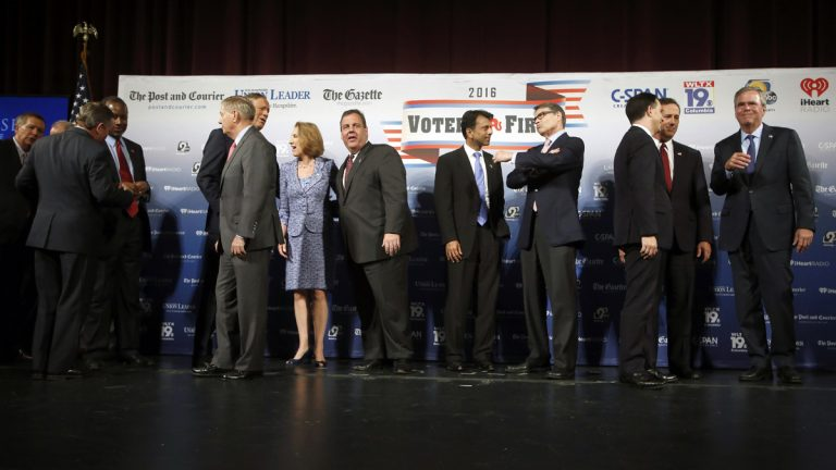 Republican presidential candidates speak among themselves after last night's forum in N.H.  Steven DiSalvo. (AP Photo/Jim Cole)