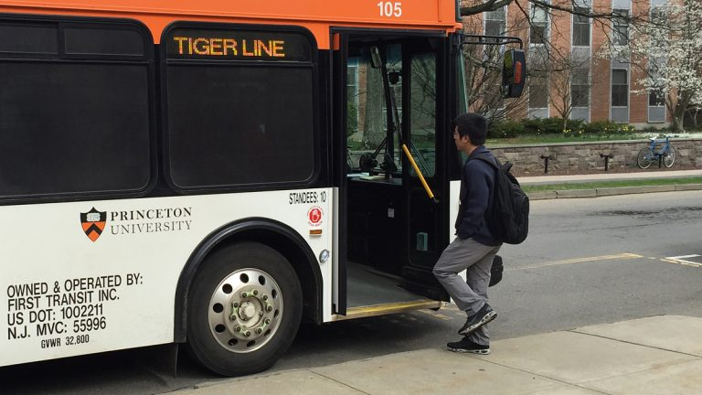 A university bus picks up a student in front of the Friend Center for Engineering Education in Princeton, NJ. (Alan Tu/WHYY, file)
