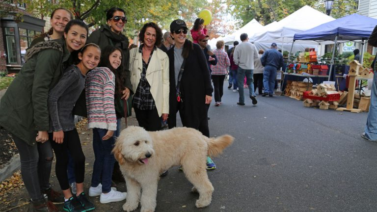 Neighbors Rocky, Levin and Etish families enjoying a stroll on Tanner Street (Natavan Werbock/for NewsWorks)