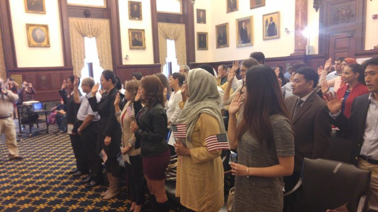 Thirty-three men and women from 19 countries took the Oath of Citizenship at City Hall in Philadelphia Wednesday.(Tom MacDonald/WHYY)