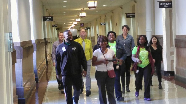 City Councilwoman Blondell Reynolds Brown leads a group of city workers on one of their twice-weekly walks along the corridors of  City Hall. (Tom MacDonald/WHYY)