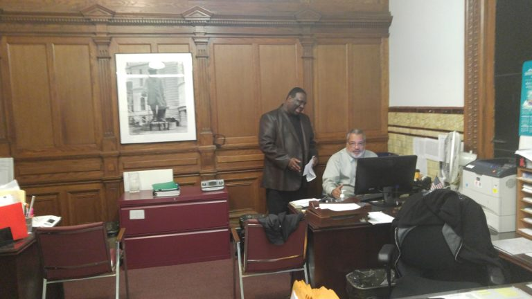 Philadelphia City Commissioner Anthony Clark, left, was in his office on Monday. (Tom MacDonald/WHYY)