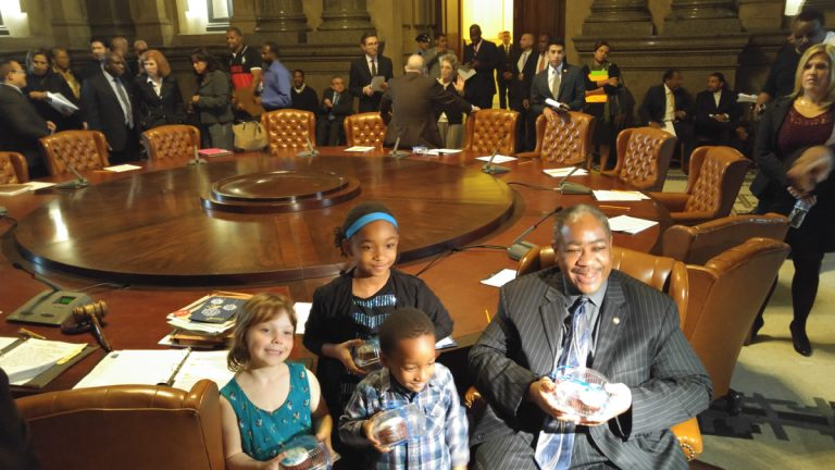Philadelphia students brought cupcakes to the Thursday meeting of City Council in thanks for a $25 million infusion to the struggling school district. Seated with some of the children, Councilman Wilson Goode Jr.is all smiles. (Tom MacDonald/WHYY)
