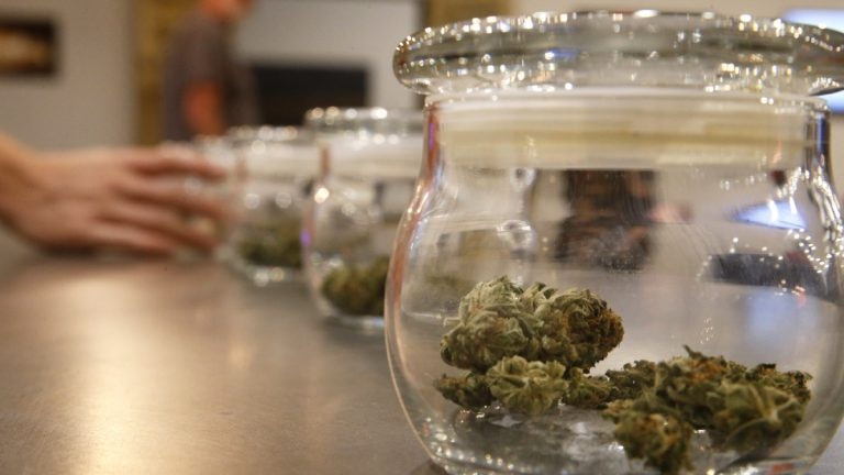 Marijuana for sale is kept in jars at the Colorado Harvest Company. (AP Photo/Brennan Linsley)