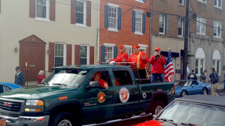 Veterans ride down the street at the annual parade in Delaware County. (Tom MacDonald/WHYY)