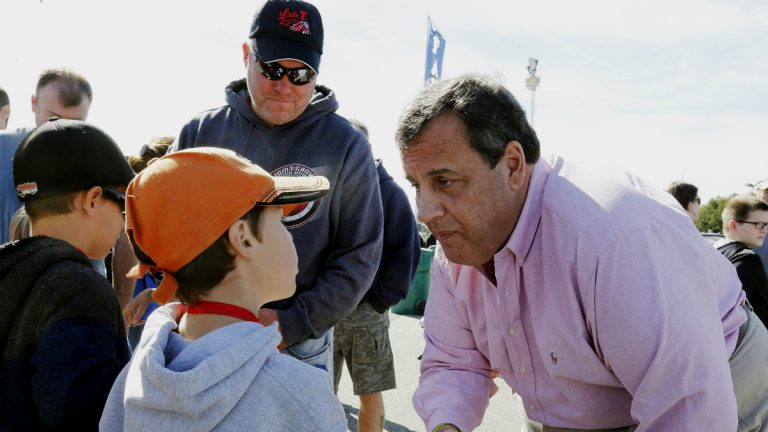 Chris Christie shakes hands with NASCAR fans at the New Hampshire Motor Speedway in September in Loudon