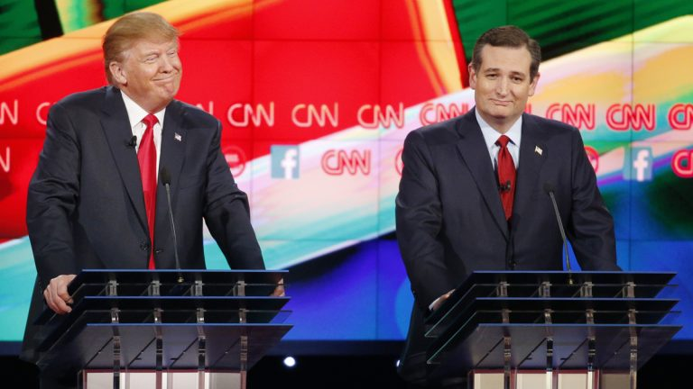Donald Trump, left, and Ted Cruz react during the CNN Republican presidential debate at the Venetian Hotel & Casino on Tuesday, Dec. 15, 2015, in Las Vegas. (AP Photo/John Locher)