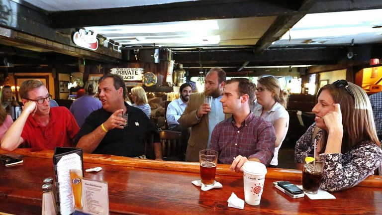 New Jersey Gov. Chris Christie meets with reporters from the New Jersey press corps for annual, off-the-record summer drinks at the Jersey Shore in 2014. Author Matt Katz is in the red shirt.(Tim Larsen/Governor's Office)