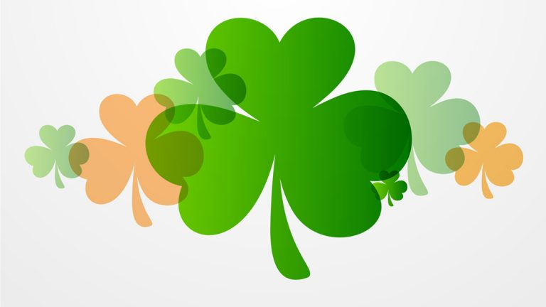 Happy St. Patrick's Day celebration background with clover leaves.