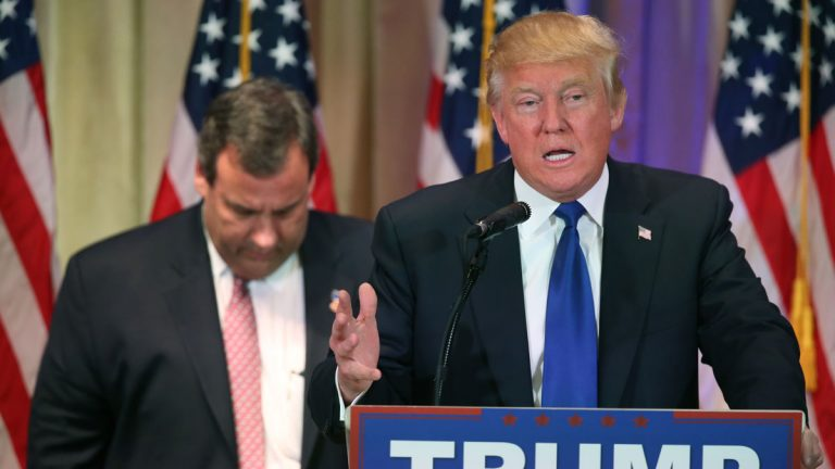 Chris Christie listens as Donald Trump speaks on Super Tuesday primary election night.  (AP Photo/Andrew Harnik)