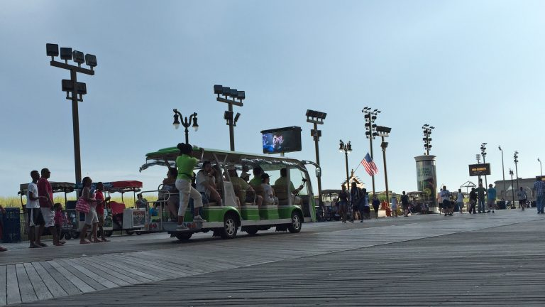 The Atlantic City Tram shuttles people up and down the Boardwalk. Alan Tu/WHYY