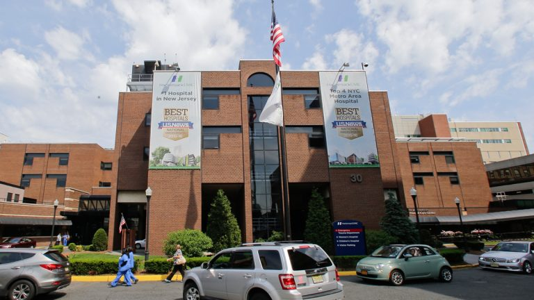 Cars pass the Hackensack University Medical Center