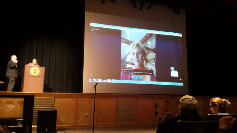 Erin Brockovich Skypes in to the meeting. (Laura Benshoff/WHYY)