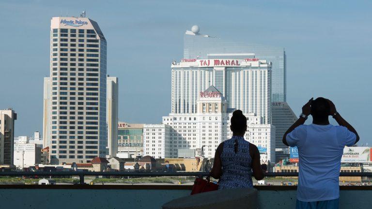 A couple looks at the Atlantic City skyline towards the Taj Mahal casino. (Alan Tu/WHYY)