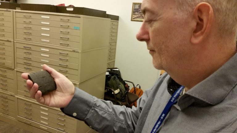 That's not a Blackberry. Philip Jones at the Penn Museum holds a 5000 year old cunieform tablet