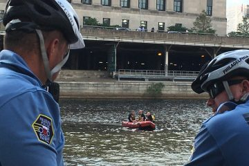 Police officers on the scene at the banks of Schuylkill river (Naomi Starobin / WHYY)