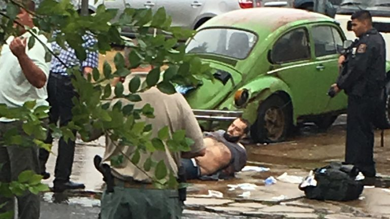 Ahmad Khan Rahami is taken into custody after a shootout with police Monday