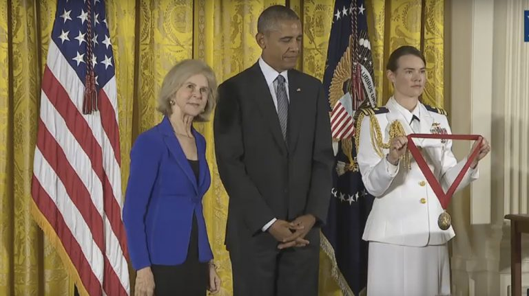 Elaine Pagels (left) about to receive a National Humanities Medal from President Obama (center) (Image  from WhiteHouse.gov)