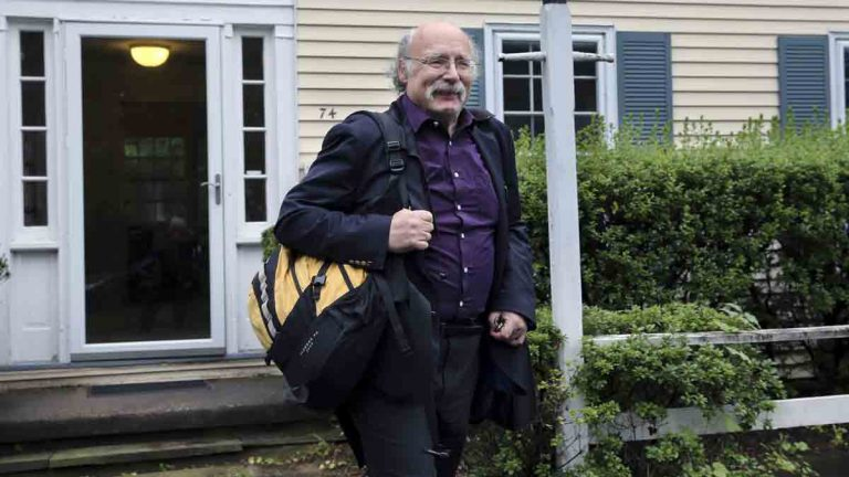 Princeton University physics professor F. Duncan Haldane leaves his home after it was announced that he and two others have been awarded the 2016 Nobel Prize in Physics early Tuesday
