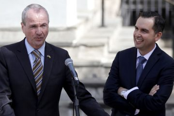 Phil Murphy (left) speaks after receiving the endorsement from Jersey City Mayor Steve Fulop.  (AP Photo/Julio Cortez)