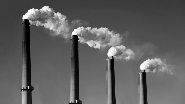 Industrial smoke stacks. (Big Stock image)