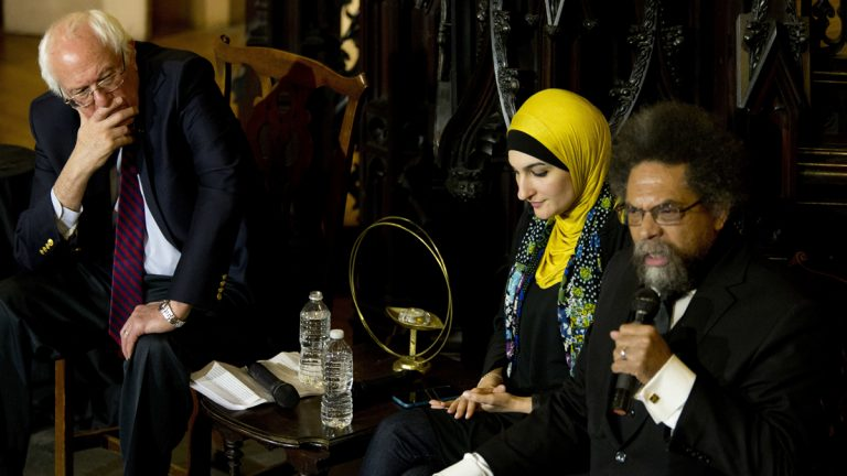 Cornel West (right) speaks as Linda Sarsour (center) and Bernie Sanders listen in Brooklyn April 16