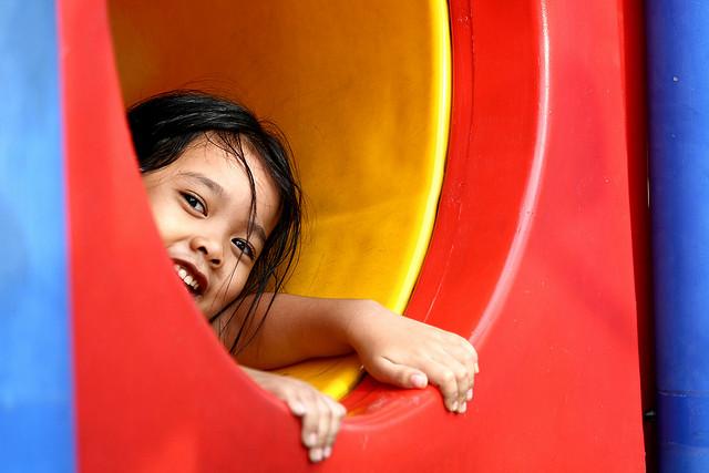 A child having fun in a playground. (Photo: phalinn via Flickr)