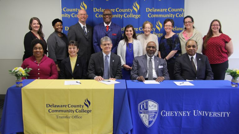 Delaware County Community College President Jerry Parker (center