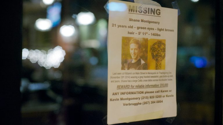 A leaflet is posted on the door of Kildare's in Manayunk. The bar on Main Street is the last place were Shane Montgomery was seen. . (Bas Slabbers/for NewsWorks)
