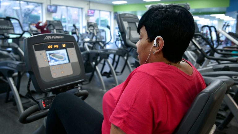 Donna Williams listens to R&B hits at the Phila U. campus gym. The Phila U. employee visits gym three times a week. (Bastiaan Slabbers/for NewsWorks)