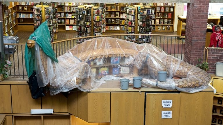 The leaky space above Ricky the Dragon will soon be repaired according to Free Library officials. (Bas Slabbers/for NewsWorks)