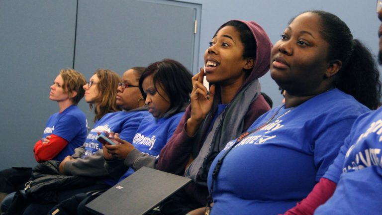 KIPP charter school supporters wait to hear whether applications for two new charters will be approved. (Emma Lee/WHYY)