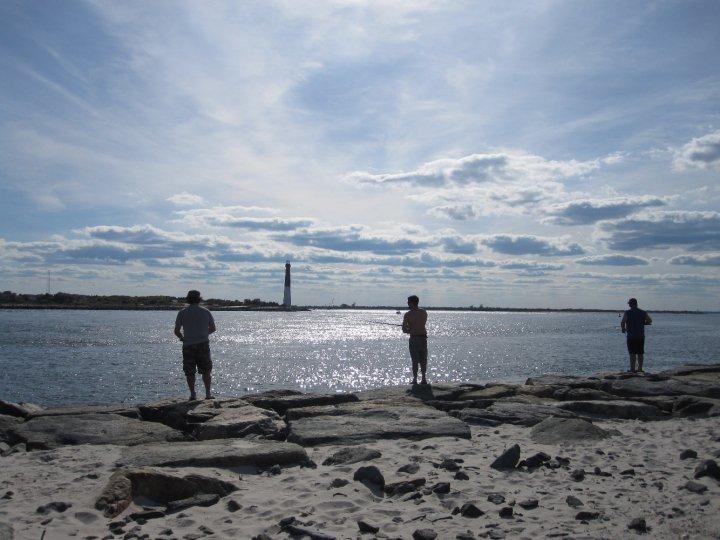 Fishermen cast from Island Beach State Park's Barnegat Inlet jetty in 2010. (Photo: Jennifer Harker/JMA Creations)
