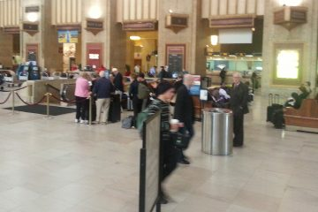 Passengers make their way through 30th Street Station in Philadelphia, Pa.  (Tom MacDonald/WHYY)