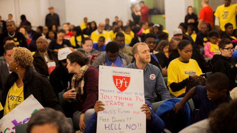 Advocates for and against converting three neighborhood schools to charters packed district headquarters Thursday night. (Photo by Brad Larrison for Newsworks)