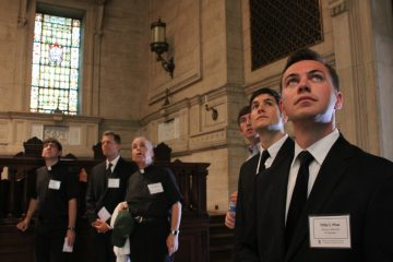 New seminarians, including (from right) Philip Maas and Giuseppe Esposito, take in the Chapel of St. Martin of Tours during a tour of St. Charles Borromeo campus. (Emma Lee/WHYY)