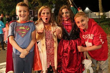 (From left to right) Jack, Maddie, Erin and Matthew from Cranberry Pines Elementary School happy to stay up late and watch the parade (Natavan Werbock/for NewsWorks)
