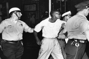A man ins arrested at 22nd Street and Columbia Avenue. (Courtesy of Temple University Libraries, Urban Archives, George D. McDowell Philadelphia Evening Bulletin Photographs Collection)