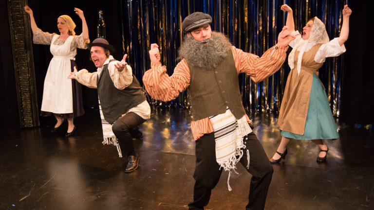 From left, Tracie Higgins, Jeffrey Coon, Tony Braithwaite and Elena Camp spoof 'Fiddler on the Roof' in 'Forbidden Broadway's GreatestHits' at Act II Playhouse in Ambler. (Photocourtesy of Mark Garvin)