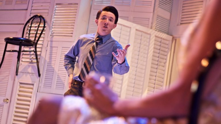 Mike Dorsey as Benjamin and in the forefront, Lori-Nan Engler as Mrs. Robinson in Eagle Theatre's production of